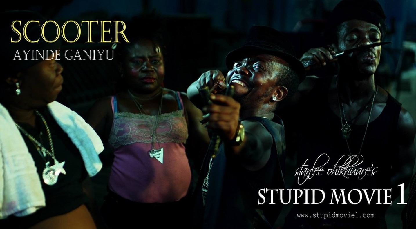 (STUPID MOVIE CAST)  AYINDE GANIYU AS SCOOTER