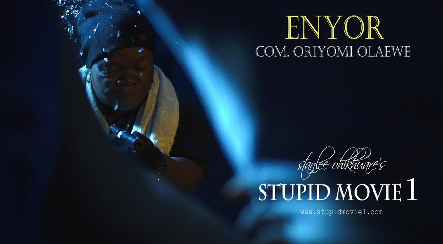 (STUPID MOVIE CAST)  COM. ORIYOMI OLAEWE AS ENYOR